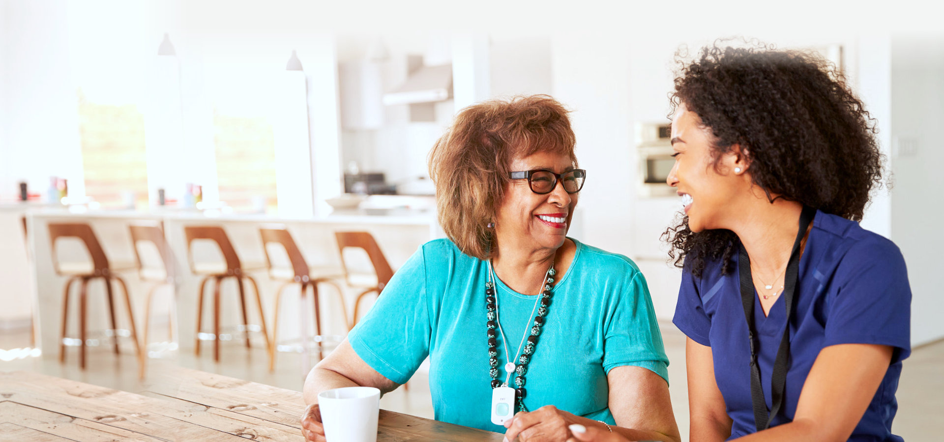 elder woman and caregiver smiling