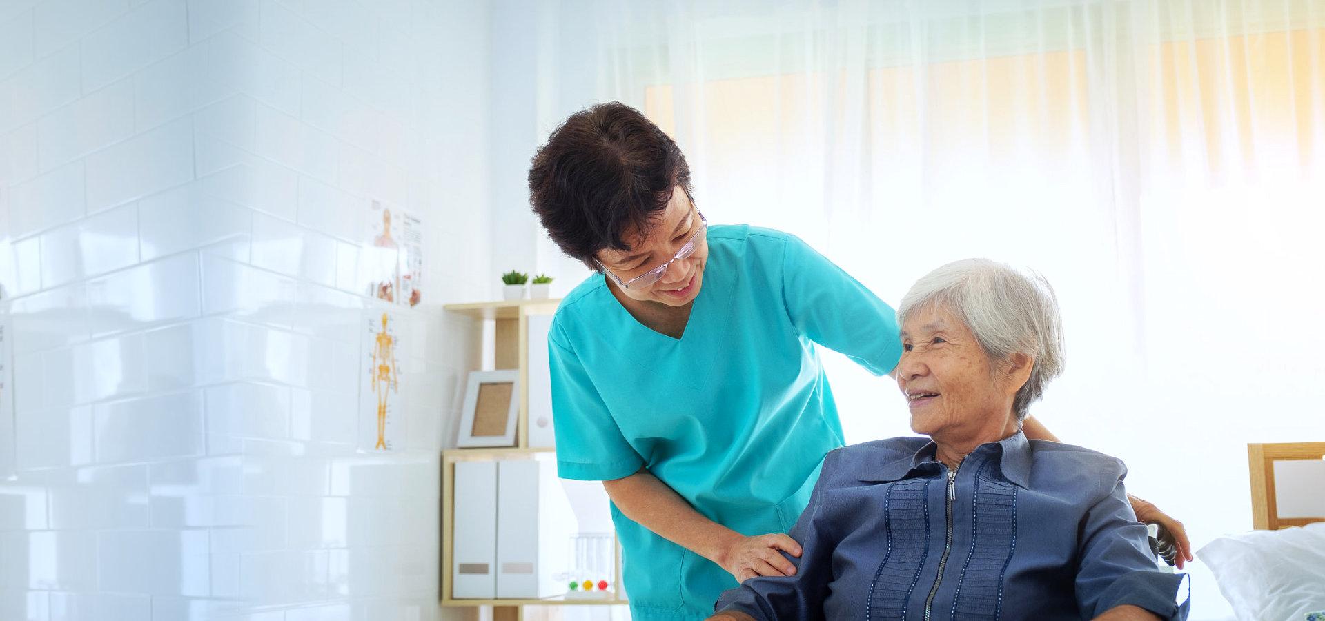 staff taking care of elder woman
