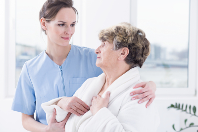 worried senior woman and her doctor holding her